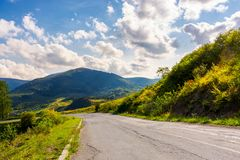 Old serpentine road in to the mountains. Beautiful nature scenery in mountainous area. lovely transportation background Royalty Free Stock Image