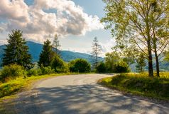Old serpentine road in to the mountains. Beautiful nature scenery in mountainous area. lovely transportation background Royalty Free Stock Images