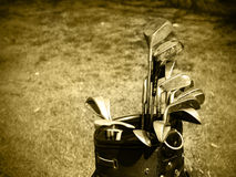 Old set of rough used golf clubs royalty free stock image