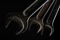 Old set of wrench tools on black background. Photo of an old set of wrench tools close up photo on black background stock photography
