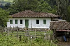 Old settler house in green landscape Royalty Free Stock Photography