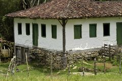 Old settler house in green landscape Royalty Free Stock Image