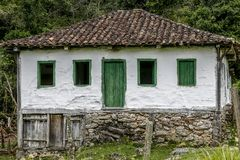 Old settler house in green landscape Royalty Free Stock Images