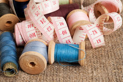 Old sewing items. On canvas background stock photography
