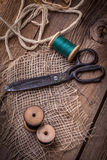 Old sewing kit on the wooden table. Stock Image
