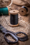 Old sewing kit on the wooden table. Stock Photo