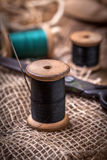 Old sewing kit on the wooden table. Royalty Free Stock Photos