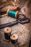 Old sewing kit on the wooden table. Royalty Free Stock Photo