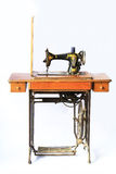 Old sewing machine. With a white background Royalty Free Stock Photography