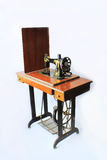 Old sewing machine. With a white background Royalty Free Stock Images