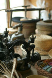 Old Sewing Machine. Old-fashioned hat-making shop with old-time sewing machine stock photos
