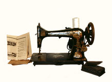 Old sewing machine. Pattern and foot pedal stock images