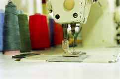 Old sewing machine. And the color thread Stock Photography