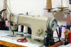 Old sewing machine. And the color thread Stock Photo