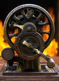 Old sewing machine. Against furnace Royalty Free Stock Photos