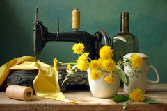 Old sewing-machine. Antique sewing-machine with spring flowers Stock Photos