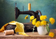 Old sewing-machine. Antique sewing-machine in yellow royalty free stock photo