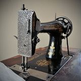 Old sewing machine of the early twentieth century. A sample of old home appliances Royalty Free Stock Photography