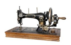Old sewing machine. Old sewing machine isolated on white background Royalty Free Stock Photo