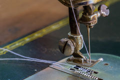 Old sewing machine and needle. Close up old sewing machine and needle Royalty Free Stock Images