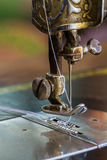 Old sewing machine and needle. Close up old sewing machine and needle Royalty Free Stock Image