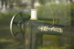 Old Sewing Machine. Photographed through a window Royalty Free Stock Images