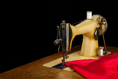 The old sewing machine and red cloth Royalty Free Stock Images