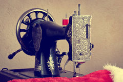 Old sewing machine with red thread Royalty Free Stock Photo