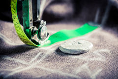 Old sewing machine with scissors, cloth and threads Stock Image
