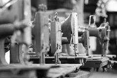 Old sewing machines in black and white Stock Images