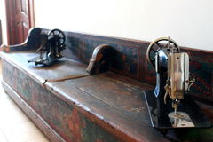Old sewing machines. On an old wooden bench valuable Royalty Free Stock Photos