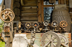 Old sewing and weaving machines tools log house stock photos