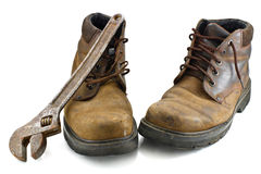 Old, shabby boots and  metalwork tool Royalty Free Stock Images