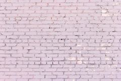 Old shabby brick wall dusty rose color texture. Painted dirty pink brick wall. Old shabby brickwork dusty rose color Stock Photography