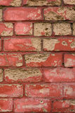 Old shabby brick wall painted red Royalty Free Stock Images