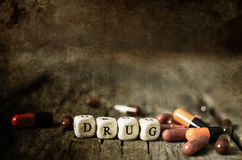 Old shabby filthy Photo drug pill on wooden table concept addict Royalty Free Stock Photography