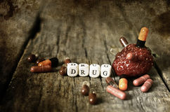 Old shabby filthy Photo drug pill on wooden table concept addict Stock Images