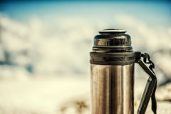 Old shabby marching thermos in winter in snow Stock Images