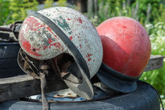 Old shabby motorcycle helmets Royalty Free Stock Image
