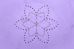 Old shabby painted metal surface . Perforated flower petal pattern. Holes in a metal. Color of the year 2018 Royalty Free Stock Photo