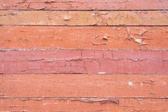 Old shabby, peeling paint on a wooden wall. stock image