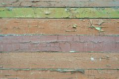 Old shabby, peeling brown, green paint on a wooden wall. royalty free stock photo