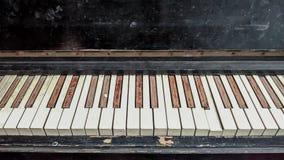 Old shabby piano keys. Background royalty free stock photos