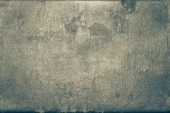 Old shabby skin of dark brass color with gloss Stock Images