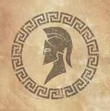 Old shabby symbol of reproduction on paper Spartan warrior in grunge style. On the image is presented old shabby symbol of reproduction on paper Spartan warrior Stock Photography