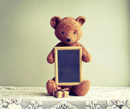 Old shabby toy bear with photo frame Stock Photography