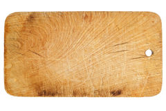The old, shabby, used, small wooden chopping board isolated on a white background Royalty Free Stock Image