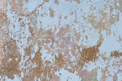 Old and shabby wall texture. Old, worn and scuffed texture of plastered wall stock photo