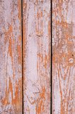 Old shabby wooden fence painted faded brown Royalty Free Stock Image