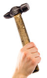 Old shabby working hammer in woman hand Royalty Free Stock Photo